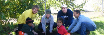 Inaugural tree planting, Harvester NeighborWoods project